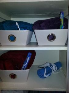 """The girlfriend closet, a week after I created it. One of my partners has already left a few more items at my house, accidentally. I've put them in her basket, so she can decide what to do with them the next time she visits.The heating pad is for """"those days."""")"""